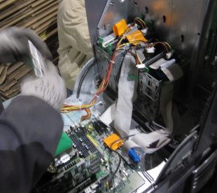 Technician removing parts from a computer