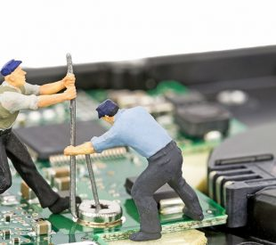 Tiny workers on a motherboard