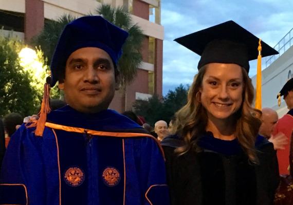 Dr. Abdullah and Dr. Bridge in graduation regalia